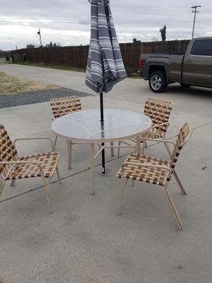 Photo 5 piece metal patio glass top table with a umbrella