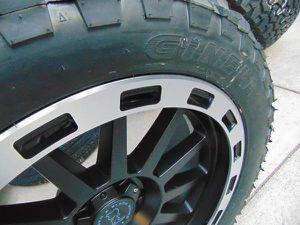 Photo 22X10 Black Wheels & LT 33 12.50 22 Mud Terrain Tires *DODGE RAM 1500*