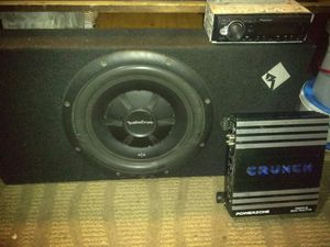 Photo 12' Rockford fosgate P2 subwoofer, Pioneer media player, Crunch 500wt amp.