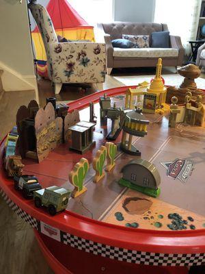KidKraft Disney Cars Radiator Springs Race Track Set and Table for Sale in Centreville, VA