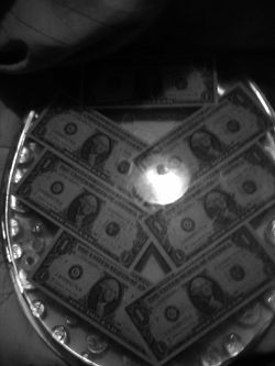 Toilet Seat with US Currency in it Thumbnail