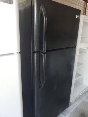 Photo Black Frigidaire refrigerator freezer