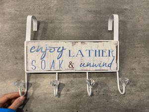 """Photo """"Enjoy, lather, soak and unwind"""" over the door towel hanger. 10.5"""" x 12"""" x 2"""". $12"""