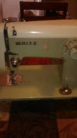 Photo Name Brand *WHITE** Model # 1466#. Old Sewing Machine .Grandmother Left. Antique sell for $100 haven't looked it might be worth a couple thousand