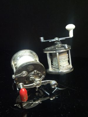 A set of two old deep sea fishing reels for Sale in Fresno, CA