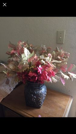 Flower vase and lot of fall leaves Thumbnail