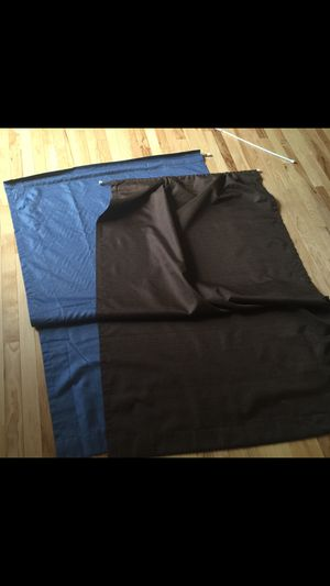 Two simple blackout curtains blue and brown with rods $5 each for Sale in Fairfax, VA