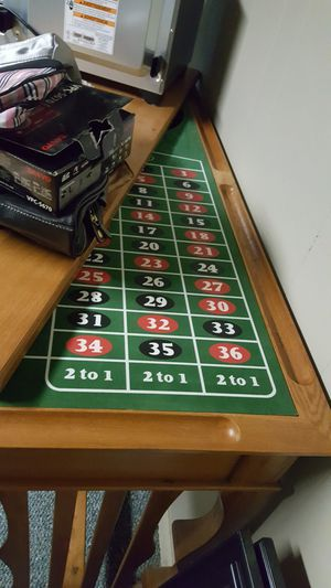 Gamming table with felt craps on one side. Roulette on opposite side. Storage under felt top. For cards, chips, etc. for sale  Afton, OK