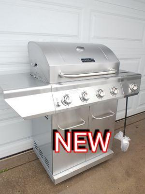 Photo New stainless steel Nexgrill 4 burner BBQ Grill