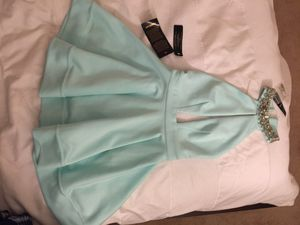 Brand new very beautiful BeBe dress size XXS with tag , color is soft mint green, paid $120 for it and asking $60 great deal if it's your size take i for Sale in Fairfax, VA