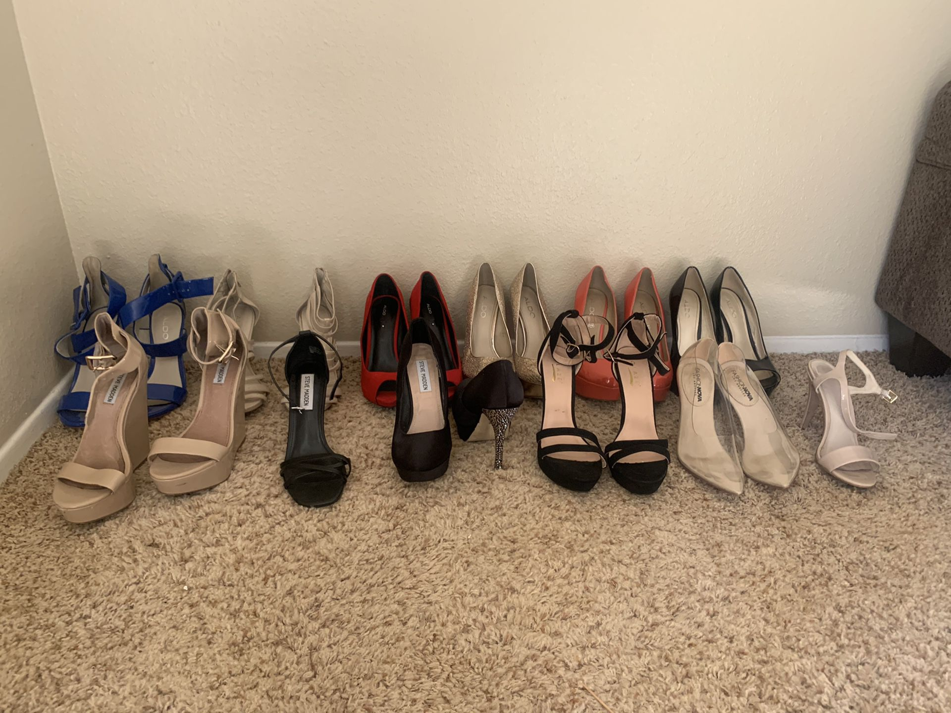 12 brand name pair of womans heels 6.5/7
