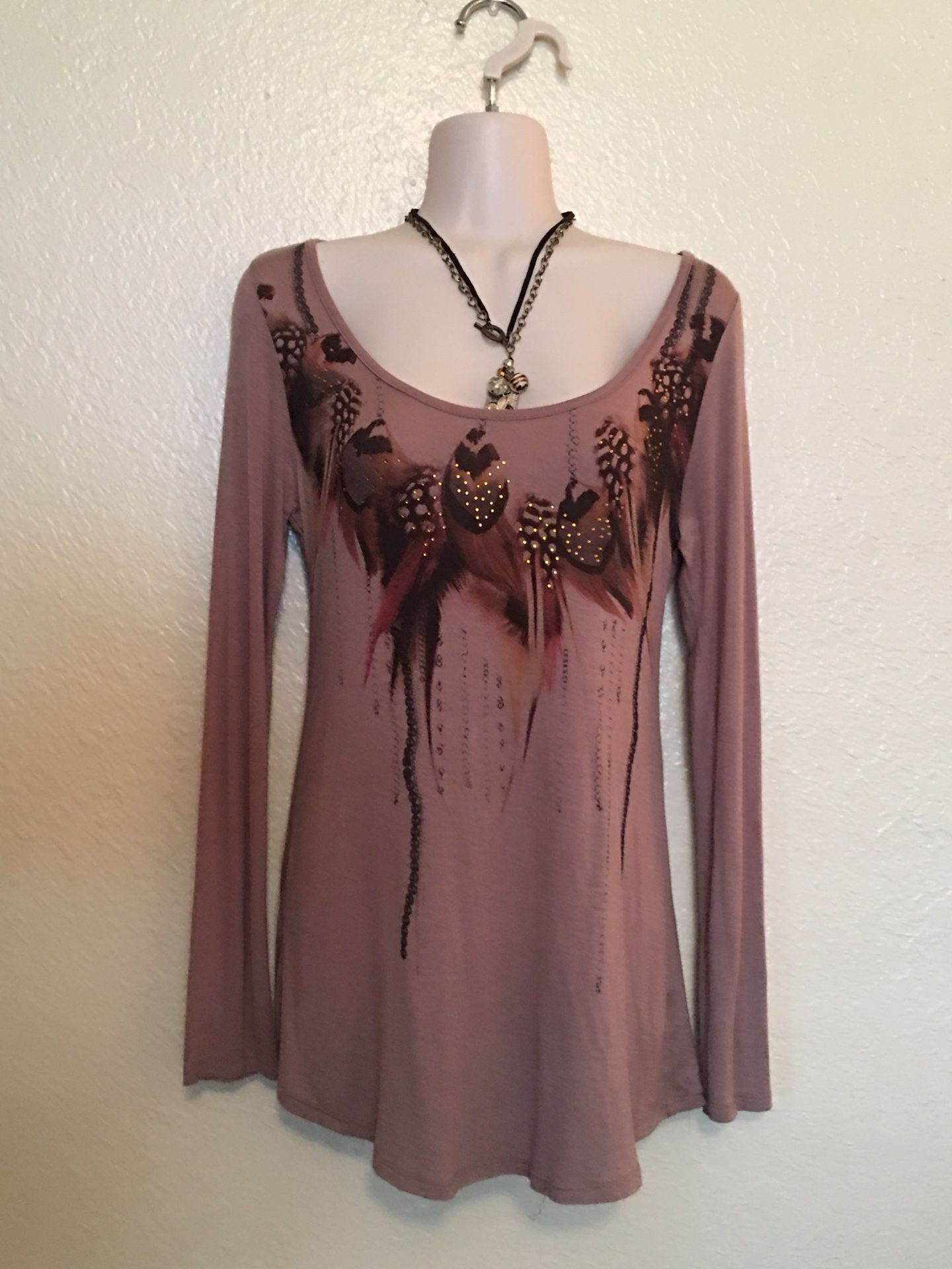 Brown small long sleeve top with slits and black lace on back