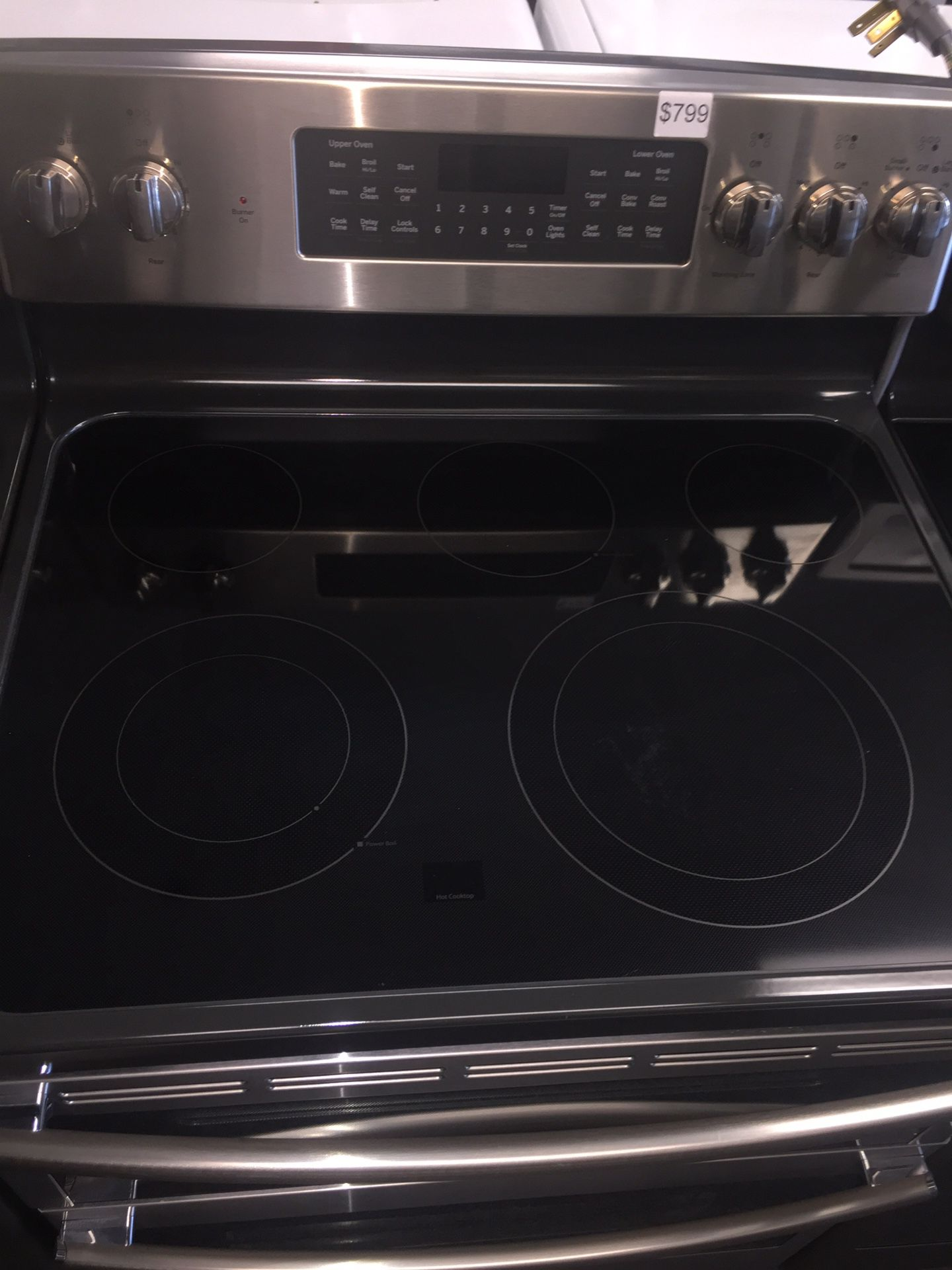 GE stainless steel electric stove double oven 6 months warranty