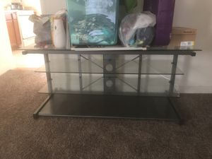 glass top tv stand for Sale in Baltimore, MD