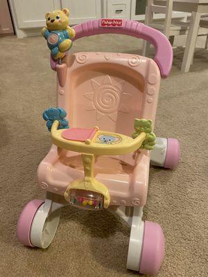 Photo Fisher Price pink toddler stroller