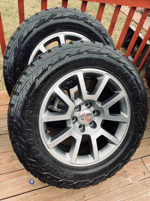 Photo 20 inch gm wheels with tires in good condition (hablo español)