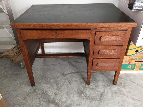 Antique oak desk. Great condition. All original. Has a black top, three  side drawers, one center drawer, and a pull out side writing surface. for  Sale in ... - Antique Oak Desk. Great Condition. All Original. Has A Black Top