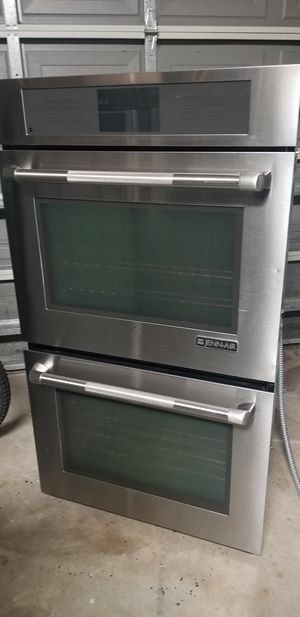 Photo Jenn Air stainless steel double wall oven, microwave drawer and glass cooktop