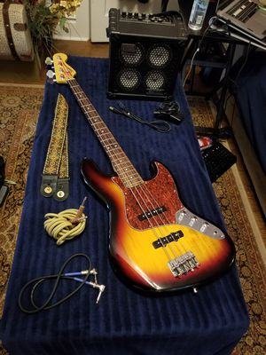 Squire Jazz Bass (Fender) w/ Bass Cube RX amplifier (Roland) for Sale in Salt Lake City, UT