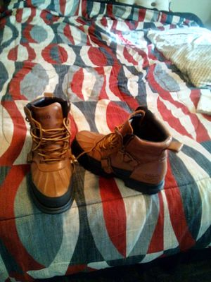 Photo Brand new orginal Polo boots size 9.5 good condition worn only twice asking 40