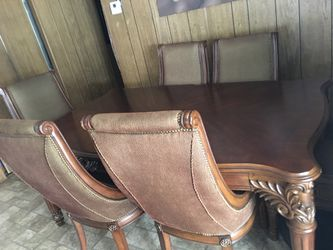 Solid wood dining table with six chairs and two extended if you want to make it bigger Thumbnail