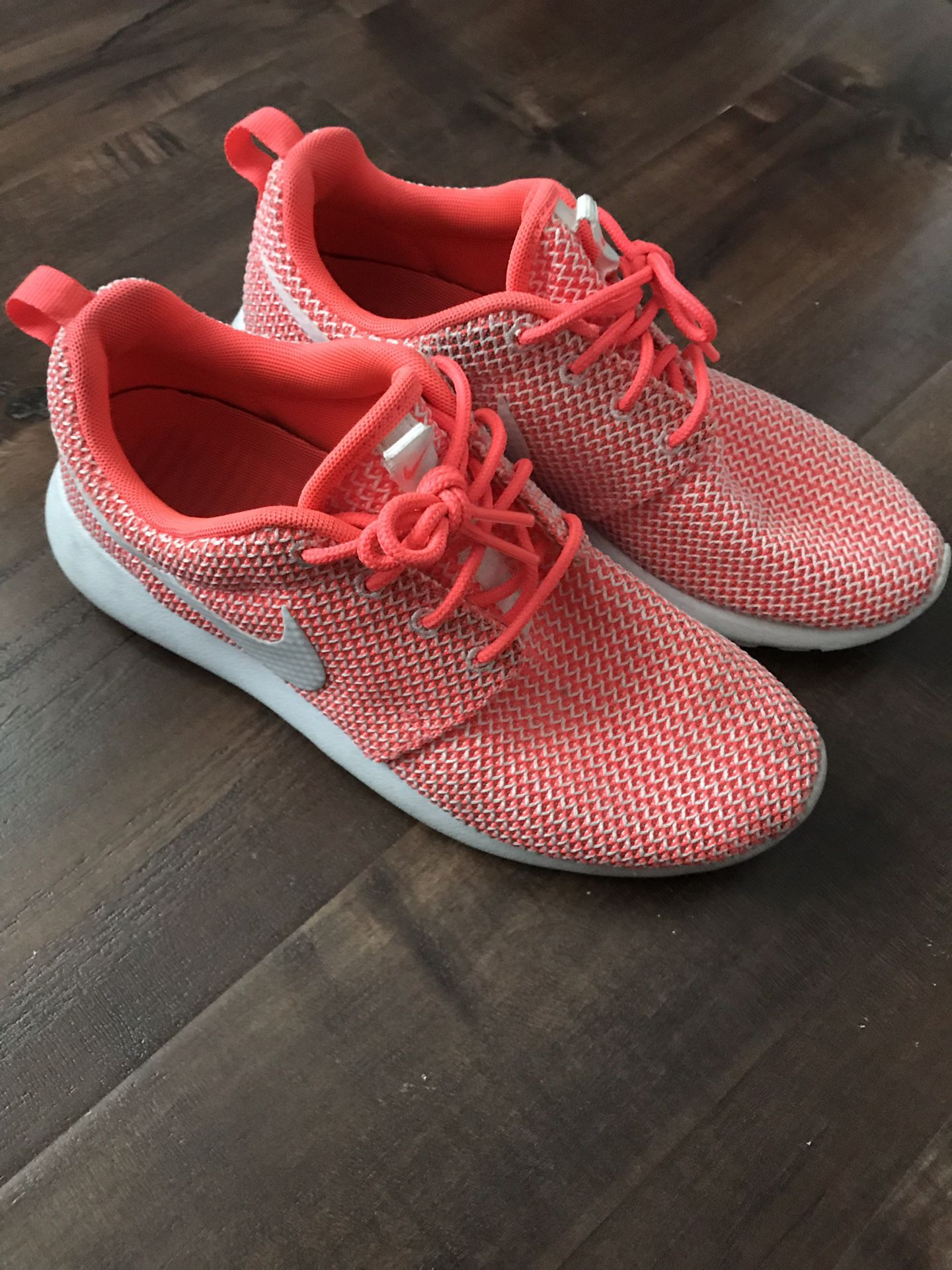 Neon pink Nike shoes