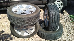 I have a set is brand new tires and wheels for GM 5 lug no caps. for Sale in Las Vegas, NV