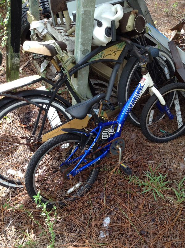 Adult Tommy Bahama beach cruiser and kids Trek BMX bike.