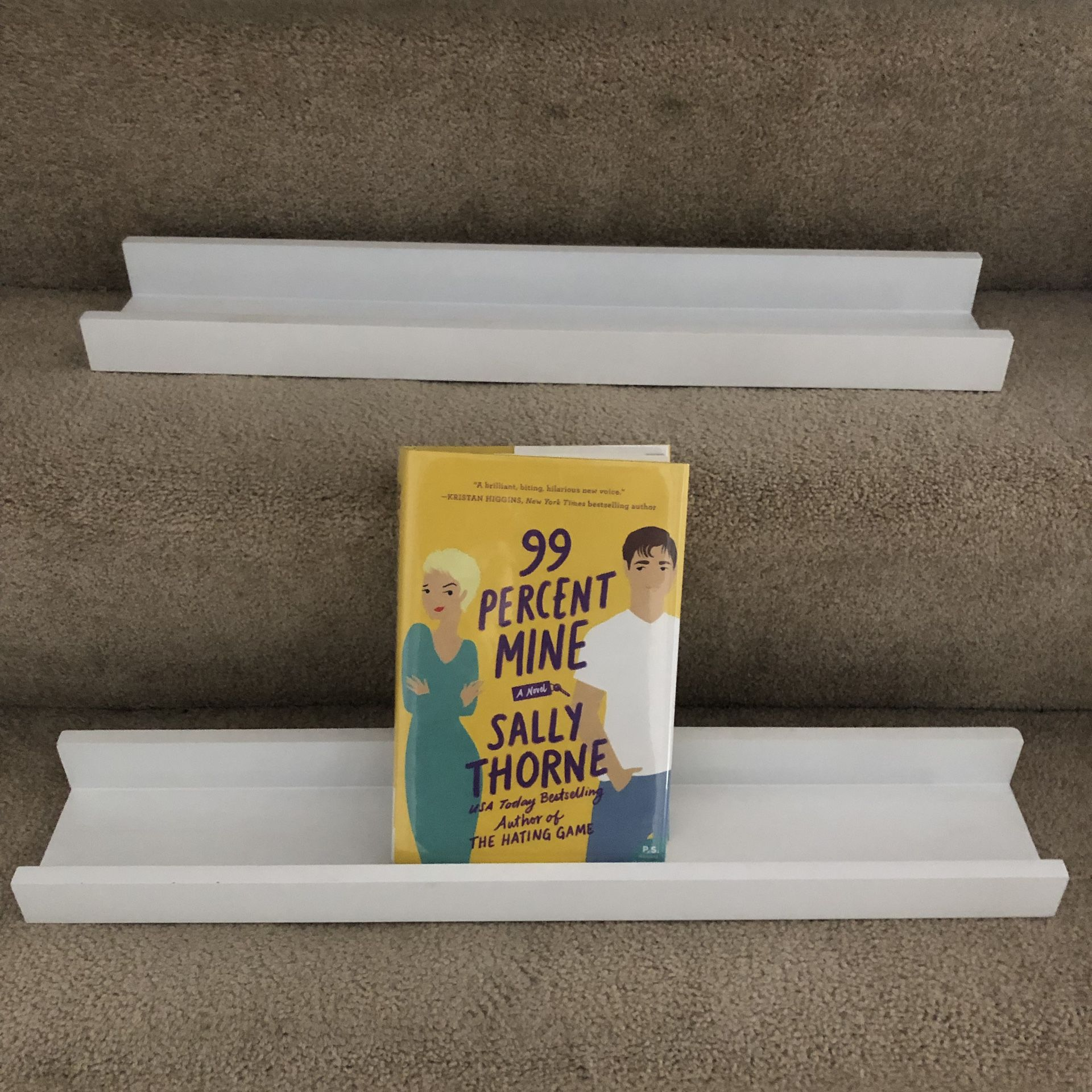Set of two white book shelves