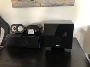 Photo Paradigm subwoofer & speakers with Rotel amp