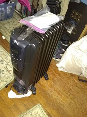 Radiator heater with remote for Sale in Alexandria, VA