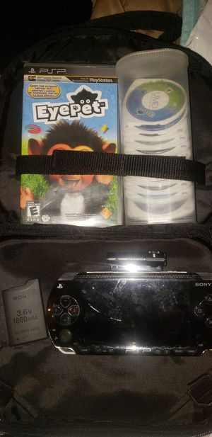 PSP fully functioning also with several games and extra battery and carrying case for Sale in Anderson, IN