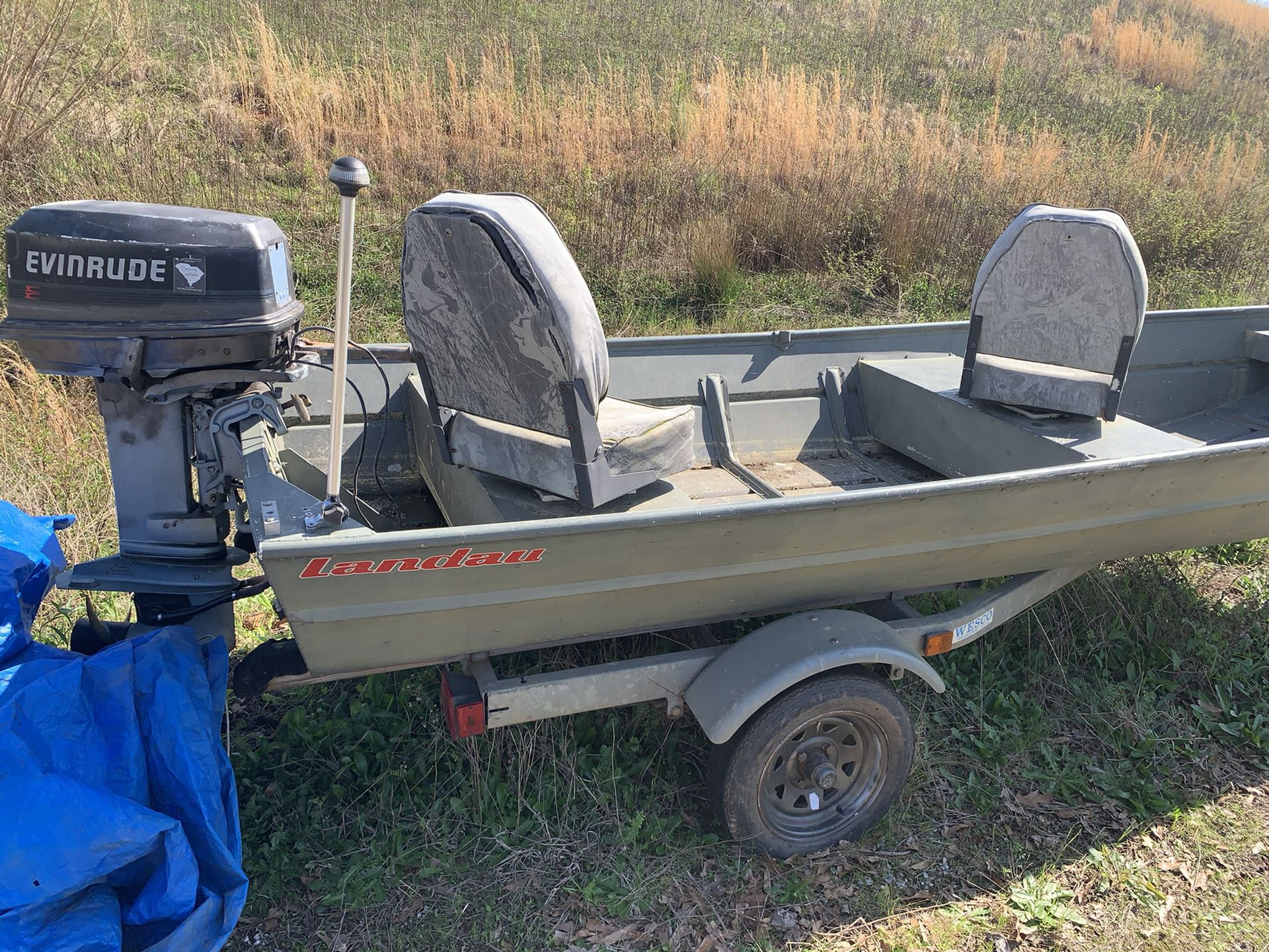 Photo 14 Foot Jon Boat With Evinrude 25 HP WITH TITLE AND DNR STICKER