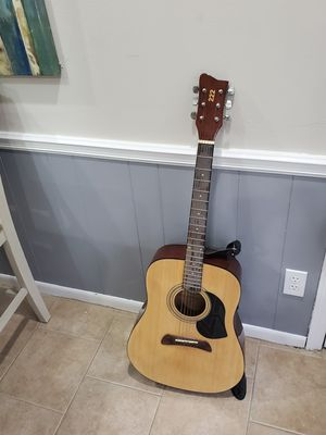 Photo First Act Acoustic Guitar