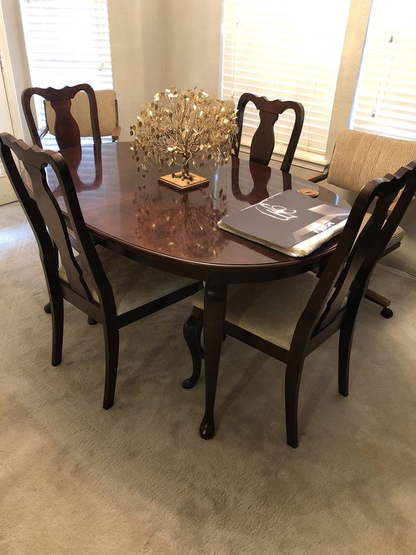 Dining Room Table With 4 Matching Chairs That Includes Leaf Is Not Shown