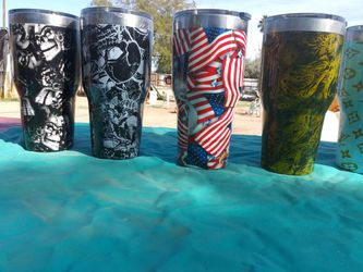 Cups for hot or cold item's Hydro dip painting on outside. Small one's hold a can for soda or beer other items can be painted as well. Thumbnail