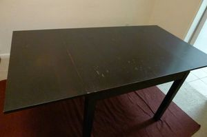 Foldable wood table with four chairs for Sale in Alexandria, VA