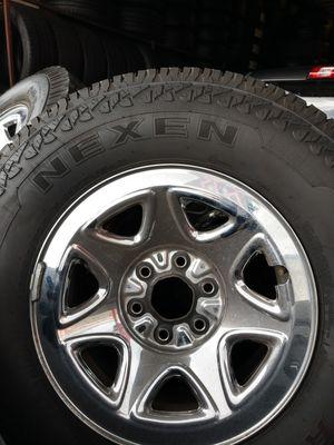 Photo For sale tires and rims 17 almost new silverado