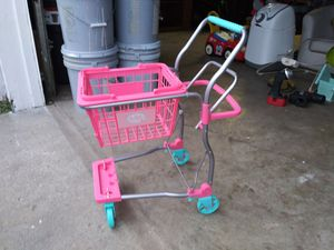 Photo Little girls shopping cart