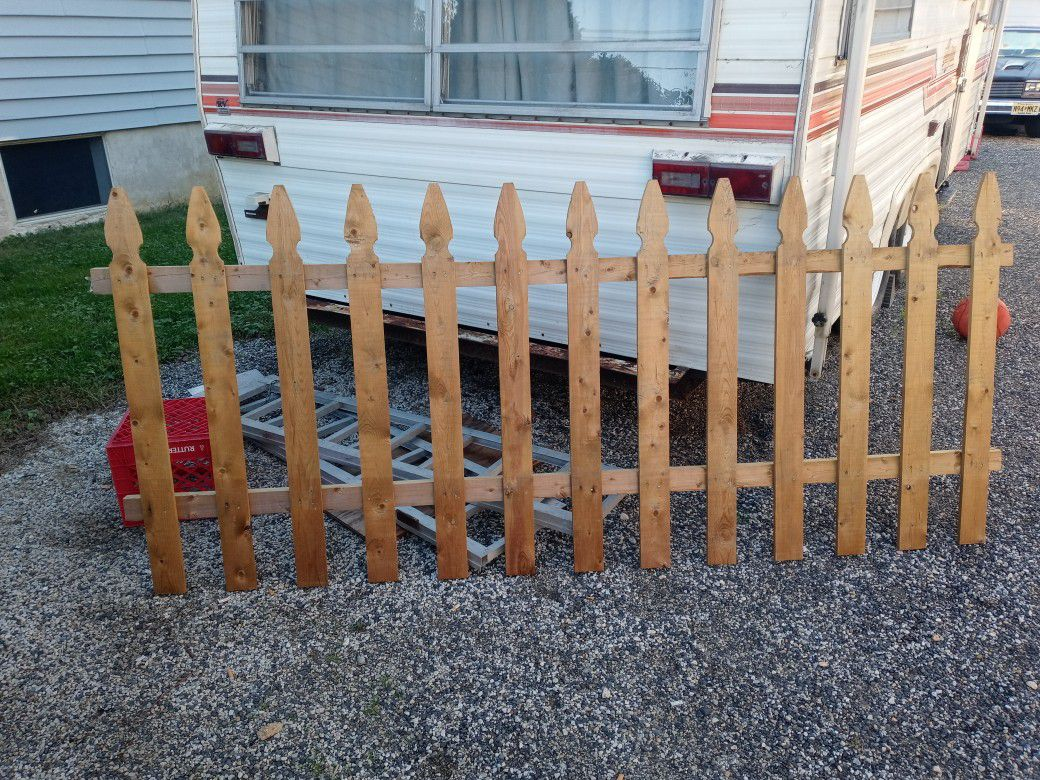 New Pressure treated 4x8 picket fence