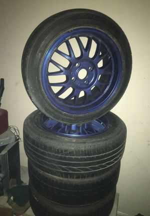 Photo 4 lugs rims and tires.