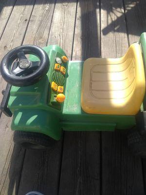Photo John Deere ride on toy,not self powered,leg power. 3/4 age group.