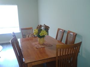 Wooden family dining table.... seats six...extends to larger table for Sale in Union City, GA