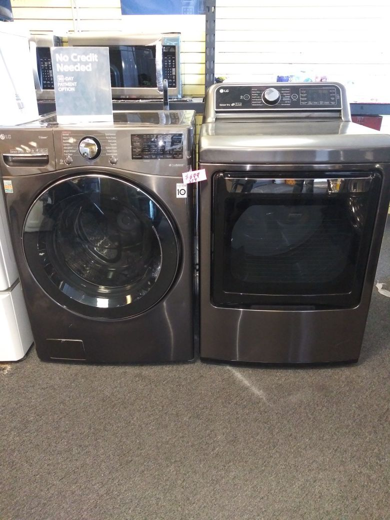 LG new scratch and dent Front load washer and used electric dryer in great condition
