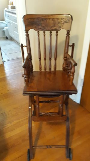 A wooden antique high chair for Sale in Birmingham, AL