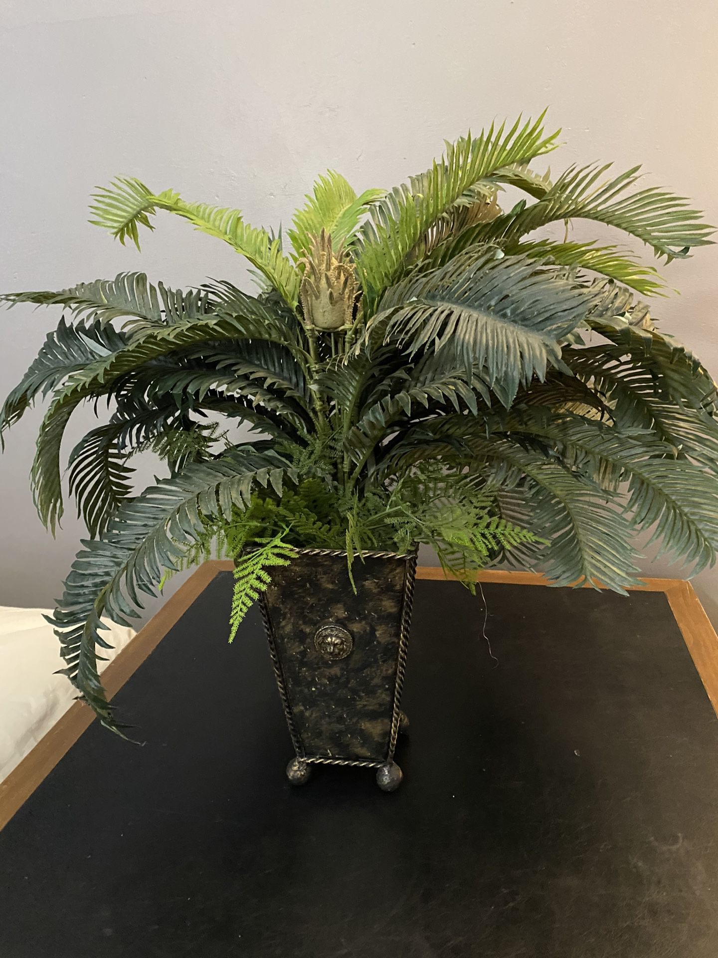 Beautiful fake green plant with vase