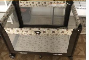 Photo Graco play and stay baby crib