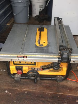 Photo Dewalt table saw Dewalt Dw715 miter saw. Chicago Electric miter saw Chicago Electric hammer drill Chicago election pro series he
