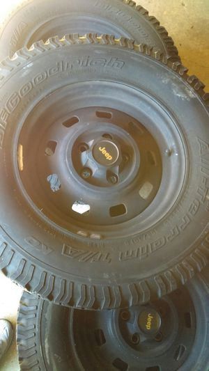 Lots of5 wheels and tires jeep wrangler 87 to 2006 very good condition size: 245/75/15 for Sale in Fort Washington, MD