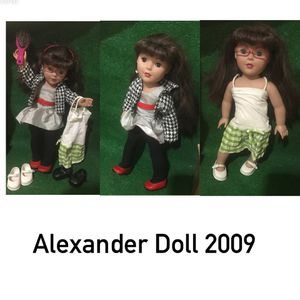 Photo Alexander Doll 2009 Brown Hair and Brown Eyes with 2 outfits, pink glasses, a pink hair brush, and 3 pairs of Shoes